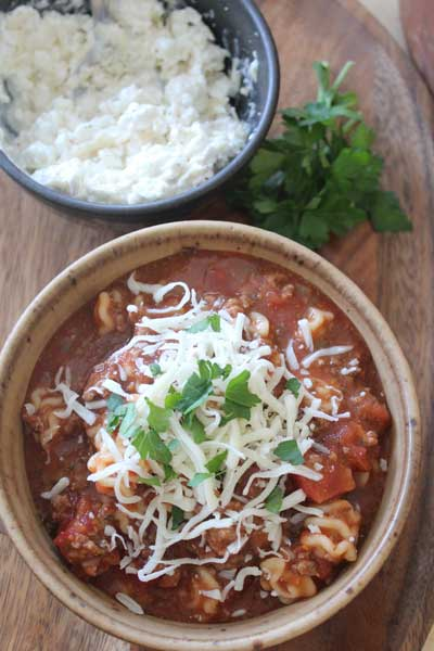 All the rich comfort flavors of lasagna, the cheesy, gooey goodness in one simple soup.  Simmer in the slow cooker and serve without any messy layer assembly.  This Lasagna Soup will warm you from the inside out.